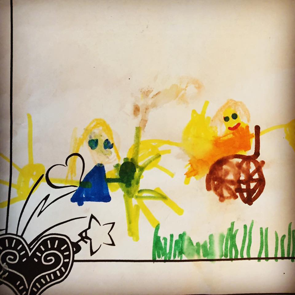 A young child's drawing of herself and her friend with a wheelchair.
